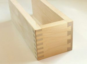 Half-built wooden pine box with dovetail joints