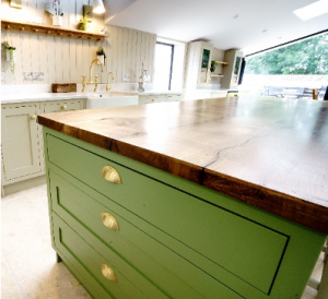 Three green pan drawers with gold plated handles