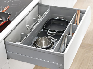 Large pull out pan drawer with cooking utensils inside
