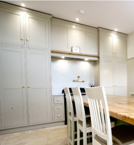 White larder cupboards neatly tucked away